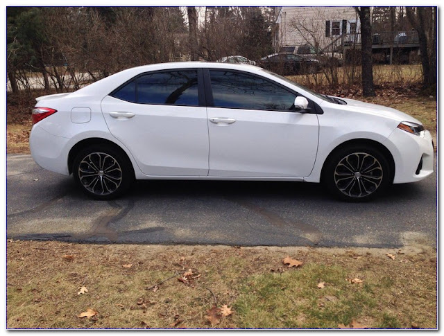 White Toyota Corolla With TINTED WINDOWS Pictures