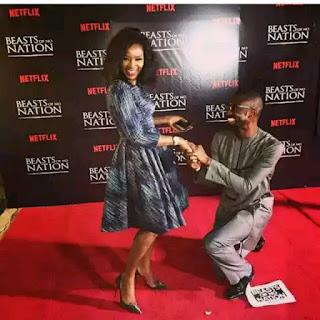 Okonjo-Iweala's Son Uzodinma Kneels To 'Propose' To Genevieve Nnaji (Photo)