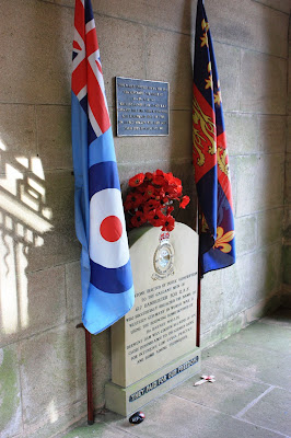 Photo showing a memorial to the Dambusters, with flags either side.