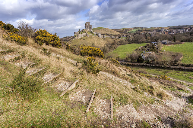 West Hill foreground steps with Corfe Castle in the background in Dorset