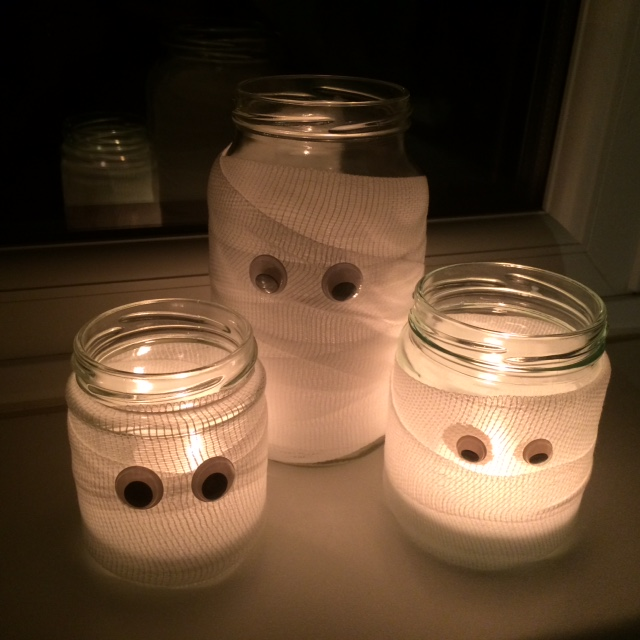 Glass jars, with bandages around and googly eyes to make them look like mummies