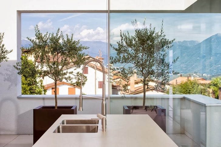 Kitchen view in Beautiful House Lombardo by Philipp Architekten