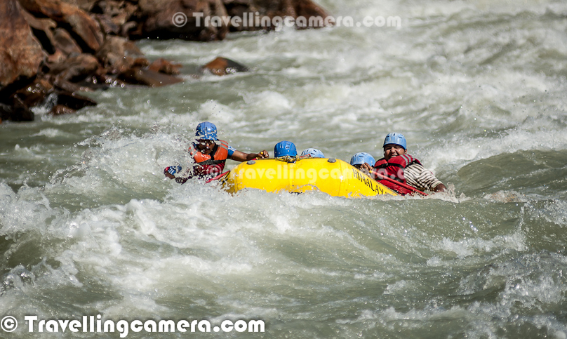 Rafting or white water rafting is one of the challenging recreational outdoor activity using an inflatable raft to navigate a river or other bodies of water having different levels of water-current. This is usually done on white water or different degrees of rough water, in order to thrill and excite the raft passengers. Rafting is considered an extreme sport, as it can be dangerous as times. This Photo Journey shares some of the photographs of Rafting in Risikesh, which is one of the popular places in India to do White Water Rafting.Recently we were in Rishikesh with office friends and Rafting was one of the top item in our list of things we wanted to do. We started in bus from Aspen Camps in Rishikesh and then boarded to jeeps with rafts. We had to start from Marine Drive which is a huge Ganges beach with enough space for folks to prepare and get started. Marine Drive is a place, strategically identified to start Rafting. Shivpuri is another preferred place to start Rafting. Idea is to make people comfortable with various types of water-rapids and then gradually start enjoying various stretches in river. Ganges provides a good range of water rapids and makes rafting an unmatchable experience.Rishieksh is one of the main places to do rafting in North India. Long time back I had done rafting in Vyas River near Kullu and that time all other rafters were professionals and I was covering a particular camp for Tourism Development program. Since I was not much involved in rafting activities, I couldn't enjoy it much that time. At Rishikesh, we had a wonderful coach/leader, who made rafting experience as great fun.After reaching Marine Drive Ganges beach, everyone of us got life jackets, a pedal and helmet. All three important things were with us and coach told us the best ways of using these three. All set with tight life-jacket, well settled helmet and appropriately gripped pedals we stepped into the raft after cleaning our feet in ganges water. It's recommended not to 
