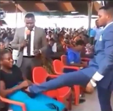 End Time: Popular Pastor Caught Stepping on Pregnant Woman's Stomach to Deliver Her from Evil Spirit (Video)