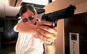 Sexy Pic Of Tom Clancy Holding A Pistol