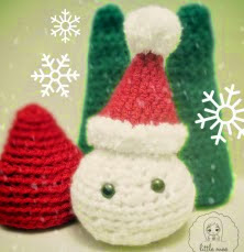 http://translate.google.es/translate?hl=es&sl=auto&tl=es&u=http%3A%2F%2Flittlemeecreations.com%2F2014%2F12%2F25%2Fmerry-christmas-santas-little-snowball-free-crochet-pattern%2F