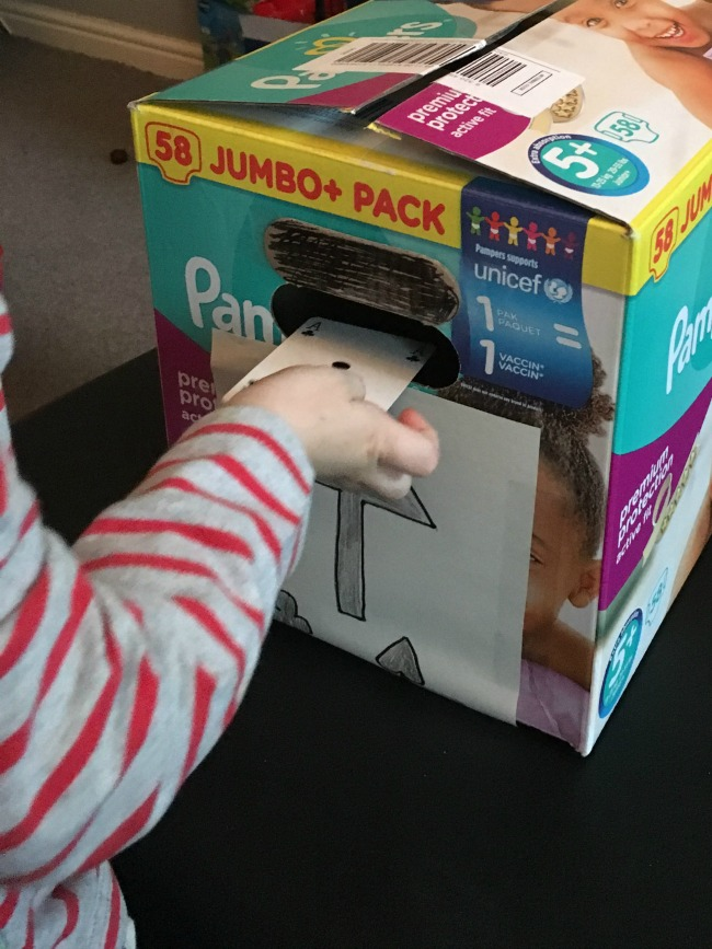 10-five-minute-games-for-toddlers-image-of-toddler-posting-card-through-hole-in-a-bax