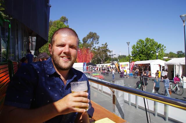 Male drinking beer along Yarra River Melbourne