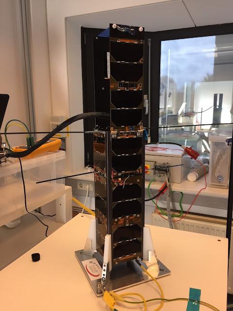 PicSat nanosatellite with its solar panels deployed. Photo Credit: Paris Observatory/LESIA