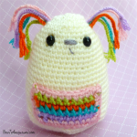 http://www.howtoamigurumi.com/amigurumi-rainbow-dog-free-pattern/
