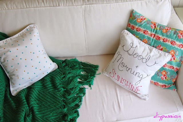 Spring pillows on a couch.