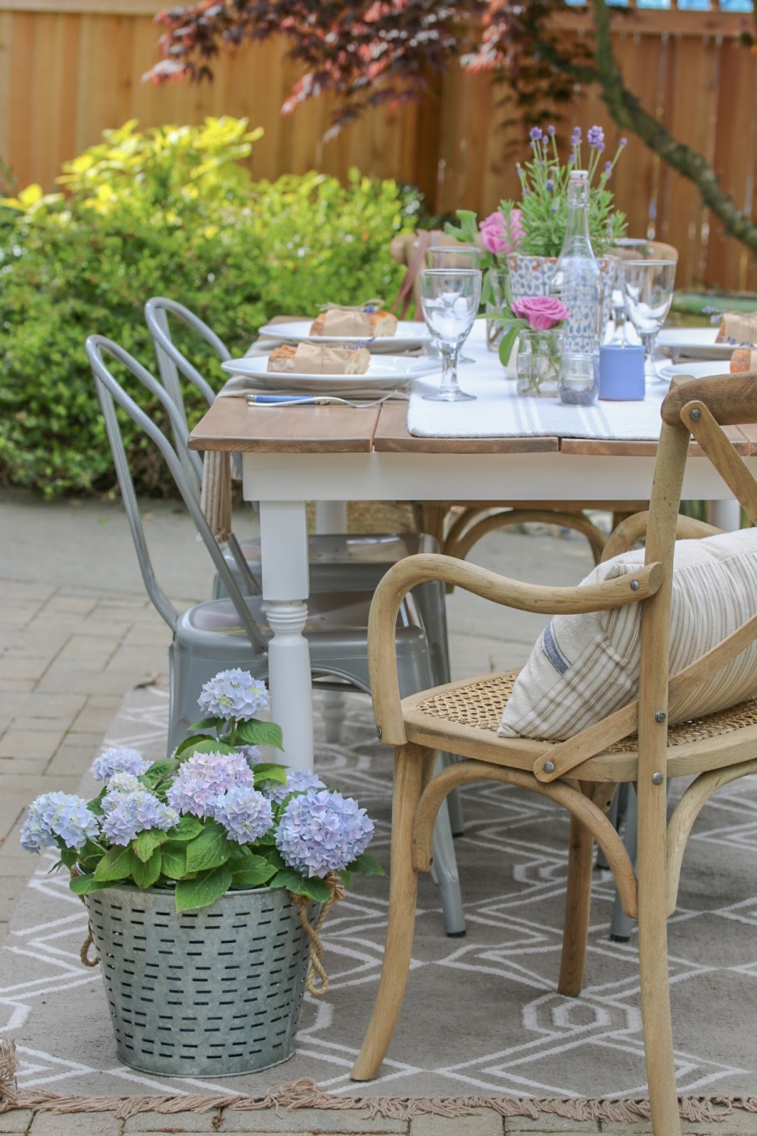 diy farmhouse table on patio with pretty table setting