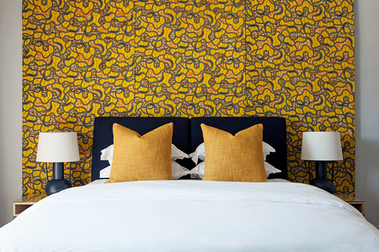 Safari Fusion blog >< [Colour crush] Yellow | Vlisco wax print fabric bedroom feature wall at Hallmark House Johannesburg, South Africa