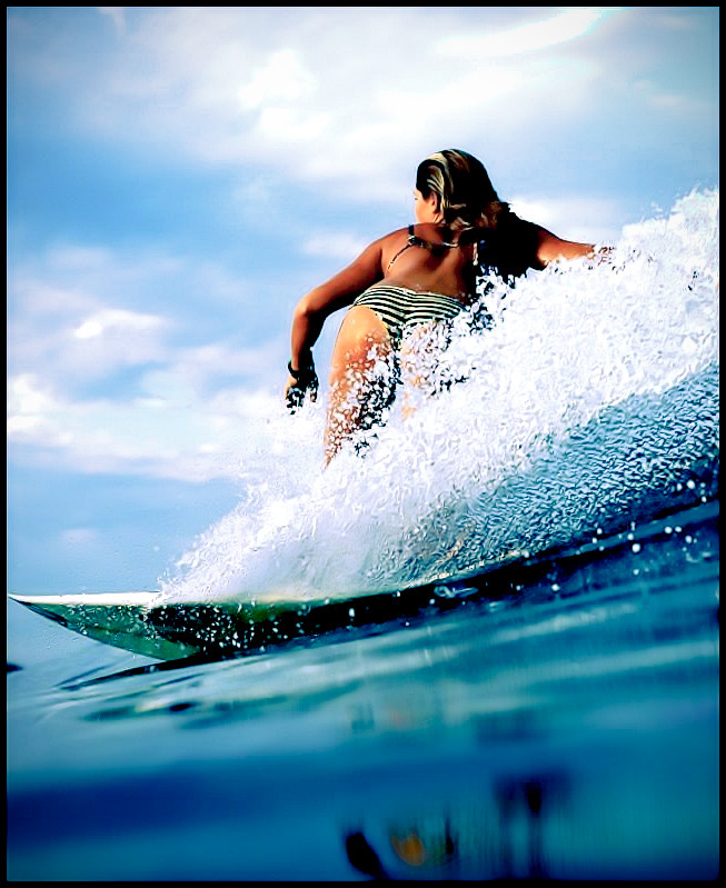 Quincy Davis carves her path on the last wave of the evening. #girlswhoshred #surfergirl #surfer #wave #surfing