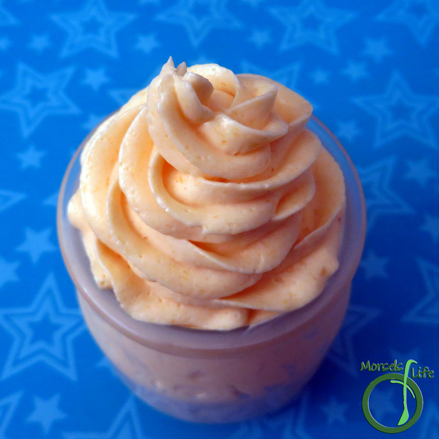 Morsels of Life - Mango Buttercream Frosting - A delightfully tropical mango puree reduction added to a rich, creamy buttercream for one fluffy mango buttercream frosting. Perfect with mango cupcakes, as a spread on toast, or just with a spoon!