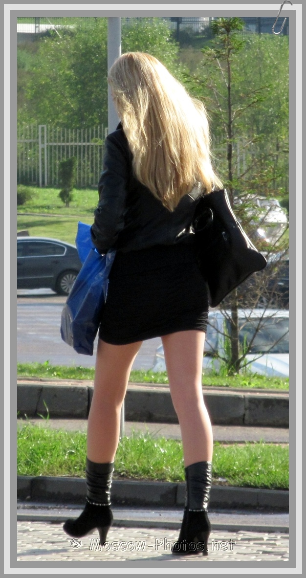 Russian Blonde Girl On High Heels Boots