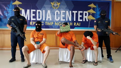 Three men arrested on unrelated drug charges in Bali were paraded for the media on Tuesday. From left: an Australian, an American and a Malaysian. Photo: Amilia Rosa