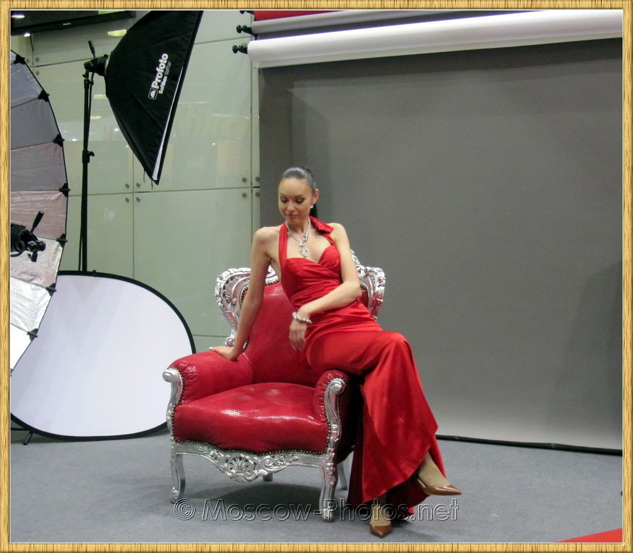 Promotional model in red dress at Photoforum