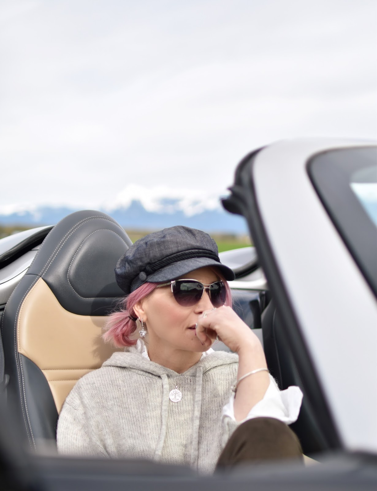 Monika Faulkner outfit inspiration - hoodie sweater, baker boy hat, sunglasses, pink hair