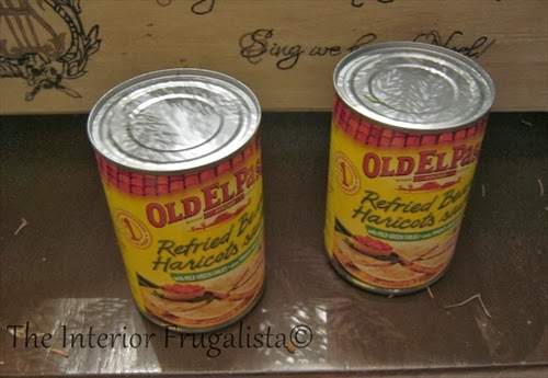 Food cans to be used as bases for candlesticks in pallet board centerpiece