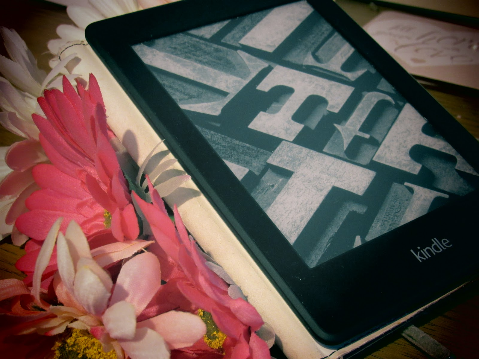Floral arrangement and Kindle