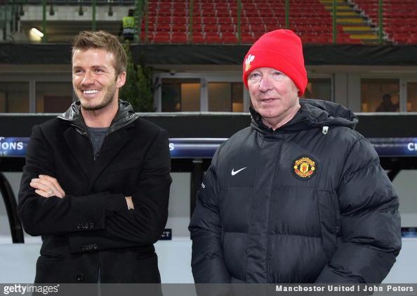 David Beckham speaks with Sir Alex Ferguson during Manchester United's training session