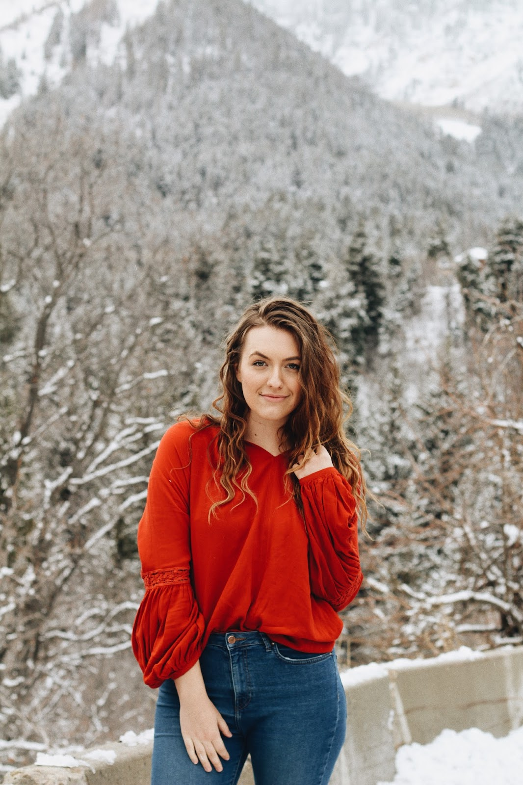 be proud of yourself lady in red portrait sundance winter mountains