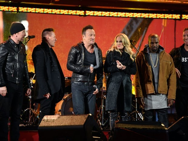 The Edge, Larry Mullen Jr., Bruce Springsteen, Carrie Underwood, Kayne West and Chris Martin