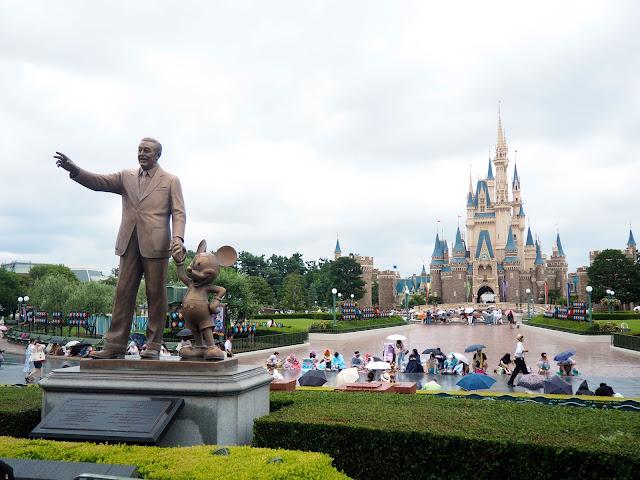 Walt Disney & Mickey Mouse statue in front of Cinderella Castle, Tokyo Disneyland, Japan