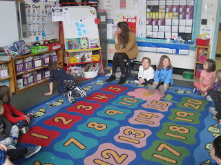 students on the rug