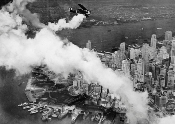 Biplane flies of Manhattan c. 1930. Areal view of old Manhattan skyline.
