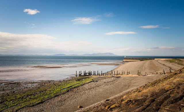Photo of the view across the shore at Maryport with the Scottish hills in the distance