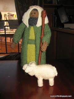 showing the lamb with the shepherd in the knitted nativity