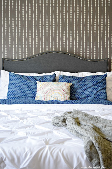 Grey and White Master Bedroom Makeover With Bold Stenciled Statement Wall