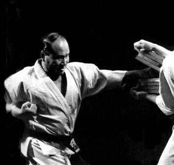 Oyama Masutatsu, the founder of Kyokushin, breaking boards as a demonstration of power and focus