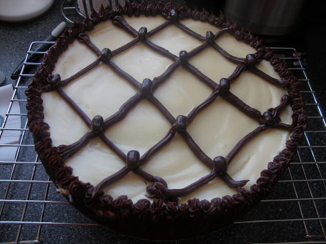 Cappicuno Fudge Cheesecake With Frosted Lines Criss Crossing