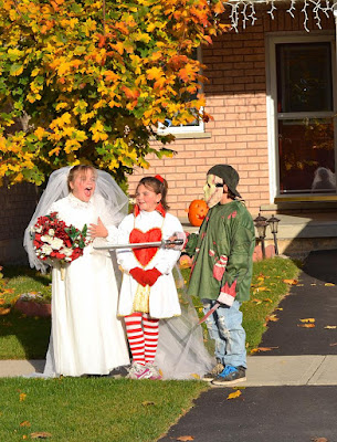 Trick or treaters on Halloween 2010 dressed as a bride, a doll and a scary character.