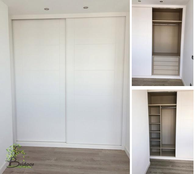 Armarios con puertas correderas lacadas y interior textil