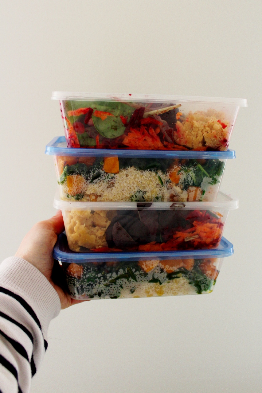 Tupperware boxes of healthy salads