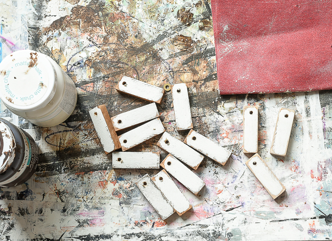 Sanding DIY Dollar Tree wood tags
