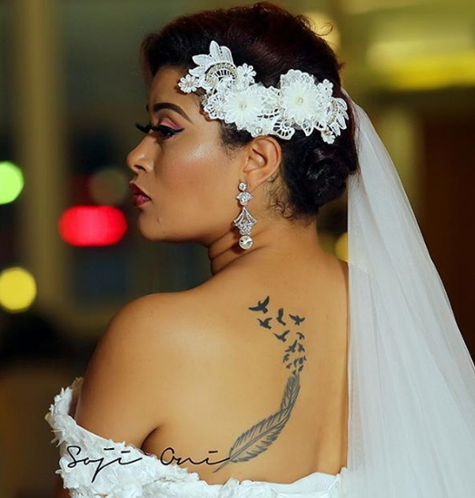 Photos adunni ade flaunts back tattoo as she rocks for Tattoos and wedding dresses