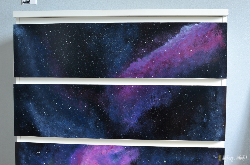 Paint a galaxy on black contact paper so that it can then be removed later if wanted