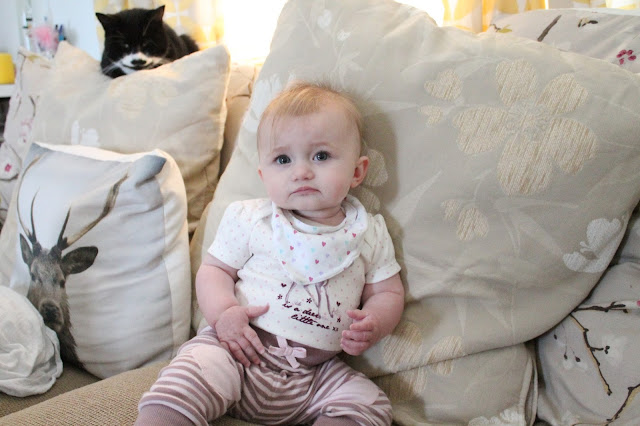 baby wearing bambi vest and trousers with heart knees