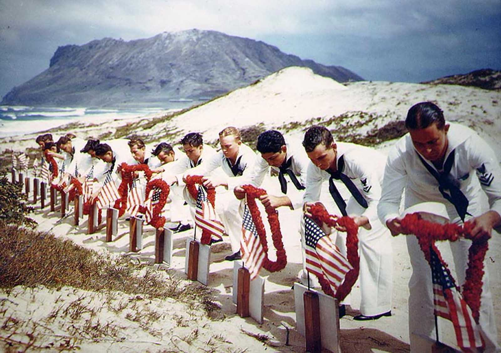 Following Hawaiian tradition, sailors honor men killed during the December 7, 1941, Japanese attack on Naval Air Station Kaneohe, Oahu. The casualties had been buried on December 8. This ceremony took place sometime during the following months.