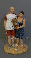 statuette coppia anniversario con cagnolino in braccio idea regalo moglie orme magiche