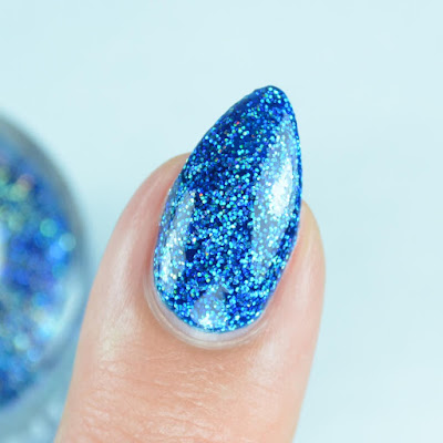 blue holo nail polish close up
