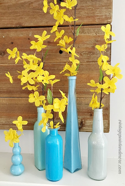 Vintage Paint and more... blue painted bottles make an easy diy for a spring mantel done in the colors blue and yellow