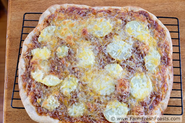 Got leftover pulled pork? Grab a potato, some cheese and some more BBQ sauce for this yummy pizza. Making something fresh out of leftovers for Friday Night Pizza Night.