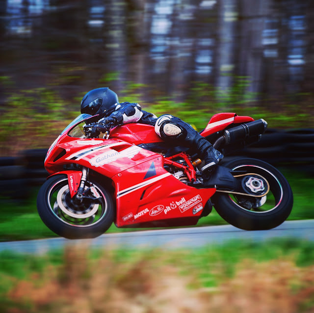 Tigh Loughhead President of Gotham Ducati racing his track bike at the Dcuati New York Track Experience at NYST