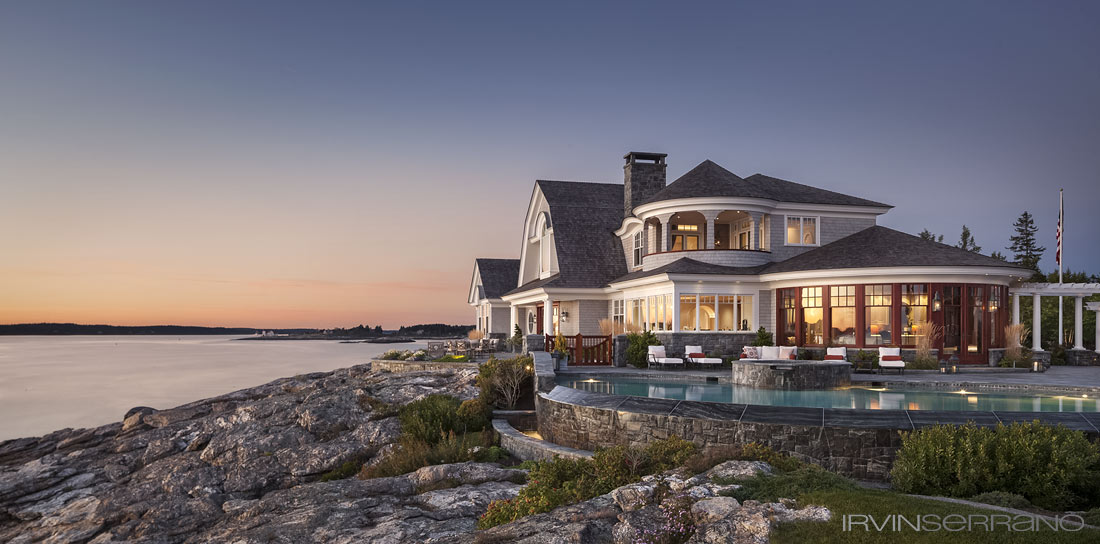 Shingle-style residential estate has mahogany accents, a vanishing edge swimming pool, a stone walled hot tub and sits on the rocky coastline of Maine overlooking the ocean.